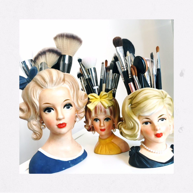 vintage ceramic woman head vases used as makeup brush holders