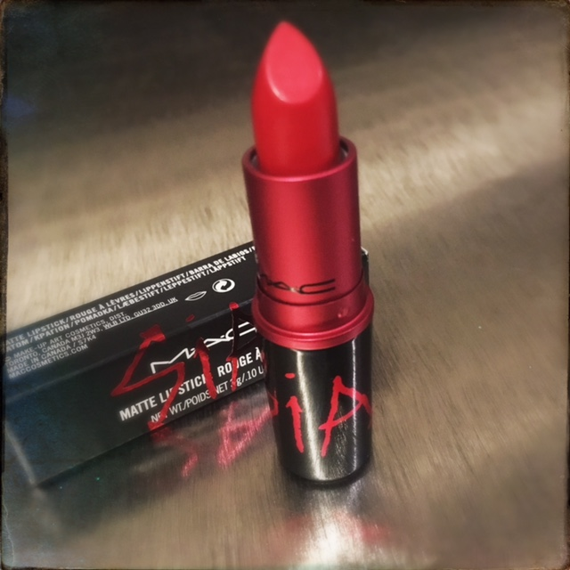 Sia Viva Glam lipstick sitting on metal table