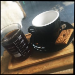 coffee and biscuit on wooden table
