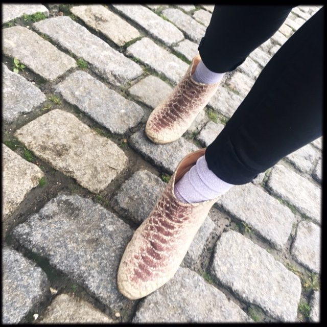 walking on cobblestones wearing ankle boots and black skinny jeans