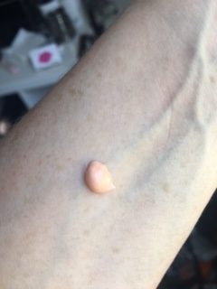blob of Nars radiance Primer on an arm to show the colour of it