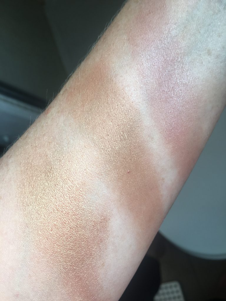 arm showing three swatches of bronzers: Dallas from benefit, NARS Laguna and Charlotte Tilbury Bar of Gold Palette