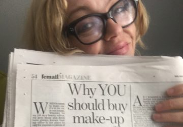 "photo of My Life In Makeup blogger Wendy Snowdon holding up an article in the email Section in The Daily Mail entitled ""Why You Should Buy Makeup Meant For Teenagers"" that she helped to write"