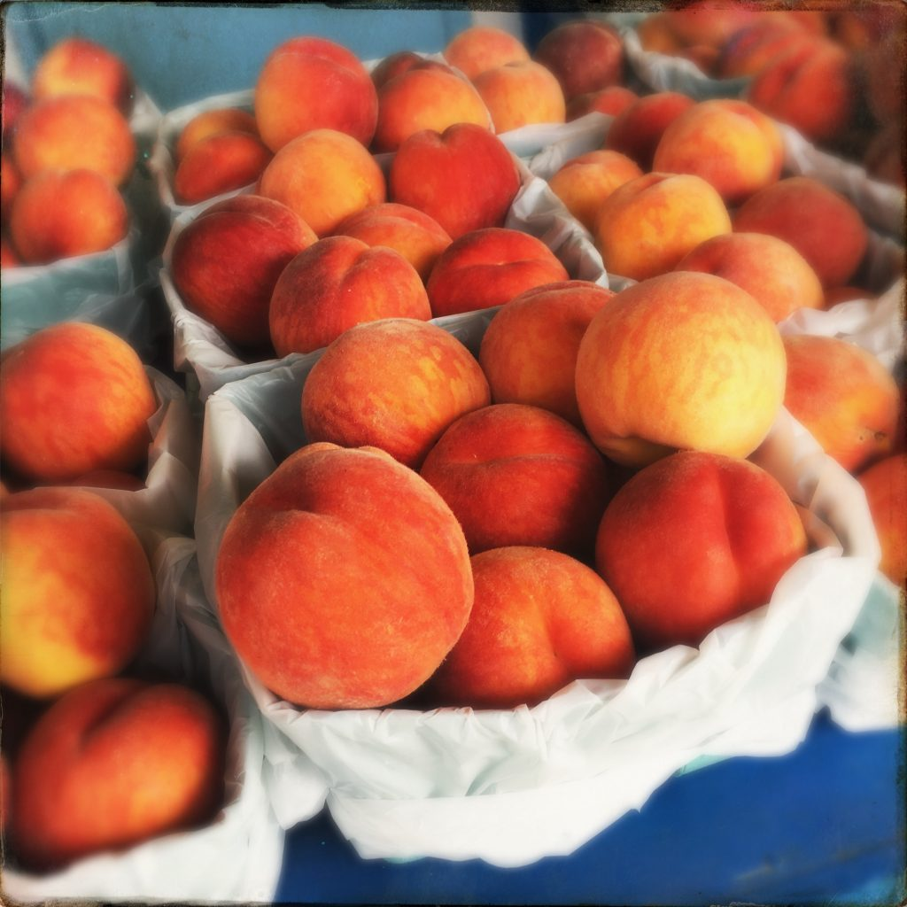 baskets of ripe peaches in Winfield BC