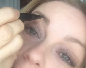 drawing on individual eyebrow hairs with the MAC Shape+Shade brow Tint felt tip applicator for a natural eyebrow.