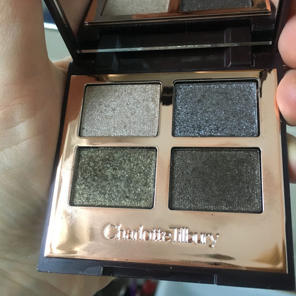 Charlotte Tilbury makeup Palette of Pops eyeshadow palette. opened and showing the four sparkly eyeshadow colours - pewter, dark green, silver and dark grey